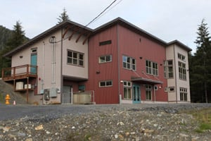 Planned as a technical center for the shareholders of the Cape Fox Corporation, this red-and-beige building off of the South Tongass Highway in Saxman, Alaska, sits empty. (Michael Grabell/ProPublica)