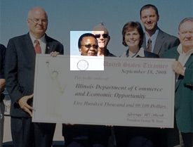 Illinois Deputy Governor Louanner Peters receives a check from the Economic Development Administration at a Sept. 18, 2008 press event.