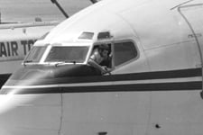 A hijacker points his pistol out the window of the cockpit of TWA Flight 847. (Herve Merliac/AP Photo, File)