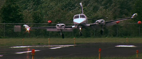 A plane lands on the resurfaced runway at Wiliamson-Sodus Airport near Lake Ontario in upstate New York. The airport is owned by the private Williamson Flying Club. (CBS News)