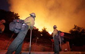 Palomar Hot Shots wait for orders as flames get close to a home on Pine Cone Rd. in the La Crescenta area of Los Angeles on Monday, Aug. 31, 2009 in the Station fire. (AP Photo/John Lazar)