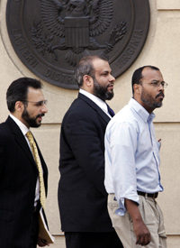 Ali al-Tamimi, center, leaves the Albert V. Bryan Courthouse, April 18, 2005, in Alexandria, Va. (Manuel Balce Ceneta/AP Photo)