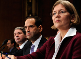 From left, Gene L. Dodaro, acting Comptroller General for GAO, TARP Special Inspector General Neil Barofsky and Elizabeth Warren, chair of the Congressional Oversight Panel for the TARP, listen to opening remarks prior to testifying before the Senate Banking Committee. (Susan Walsh/AP Photo)