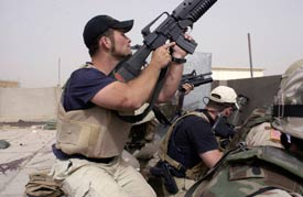 Plainclothes contractors working for Blackwater USA take part in a firefight in the Iraqi city of Najaf, April 4, 2004 (AP File Photo/Gervasio Sanchez)