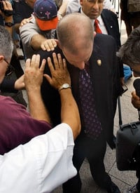 Attorney Brian Chavez-Ochoa, center, has ministers pray for him before he files a lawsuit to prevent the removal of the Ten Commandments monument from the state judicial building in Montgomery, Ala., Aug. 23, 2003. (Credit: AP Photo/Dave Martin)