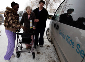 Dora Pratt, center, is helped to a waiting van as she is evacuated with all residents at the Elim Rehab & Care Center on March 26, 2009 in Fargo, N.D. (Carolyn Kaster/AP Photos)