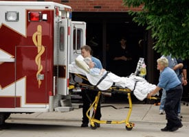A woman is evacuated from Mercy Medical Center on June 13, 2008. (AP Photo/Jeff Roberson)