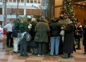 Investors inquiring about their money gather in the lobby of where Bernard L. Madoff Investment Securities LLC has their offices on Friday, Dec. 12, 2008, in New York. (Diane Bondareff/AP Photo)