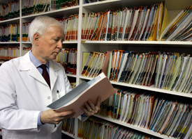 Although much of the stimulus money -- and much of the stimulus lobbying money -- dedicated to health IT is meant to increase the use of digital records, Dr. Cecil Wilson of Winter Park, Fla., says he's in no rush to convert his nearly 5,000 records from paper to digital. (John Raoux/AP Photo)