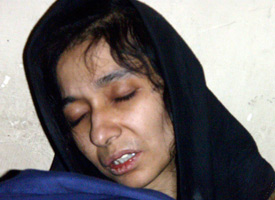 Aafia Siddiqui was arrested in Afghanistan on July 17 and is seen here in the custody of the Counterterrorism Department of Ghazni province. (Credit: AP Photo)