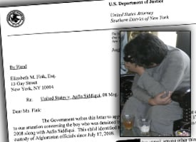 Aafia Siddiqui's alleged son, inset, covers his face while being shown to the media in Ghazni, Afghanistan. (Credit: AP Photo/File)