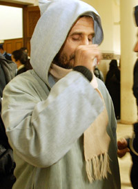 Abdellah Tabarak leaves the Rabat criminal court in Morocco in December 2004. (Credit: Jalil Bounhar/AP Photo)