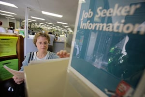 Kathryn Craven, of Palo Alto, Calif., who recently lost her job as a technical writer, looks through job seeker pamphlets at the Connect! Job Seeker Center in Sunnyvale. (Marcio Jose Sanchez/AP Photo)