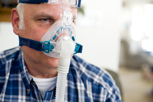 Bob Immele must wear a BiPAP, or Bi-leve Positive Airway Pressure, machine while he sleeps to get more air into his lungs. (Leah Nash/ProPublica)