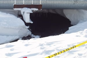 Response efforts get underway as more than 200,000 gallons of oil spill out of a corroded hole in the Prudhoe Bay pipeline into the snow in March 2006. (BPXA)