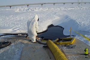 Workers respond on March 3, 2006 to the largest oil spill on Alaska's North Slope after 200,000 gallons of oil leaked from a hole in a pipeline in Prudhoe Bay. (BPXA)