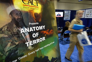 An informational seminar shown by CACI on Sept. 14, 2004. (Spencer Platt/Getty Images file photo)