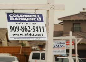 For sale signs line a residential street in Adelanto, Calif., on June 15, 2009, the first day of a state-wide 90-day moratorium on housing foreclosures. (Robyn Beck/AFP/Getty Images)