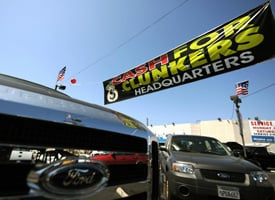 A Ford car dealer in Marina del Rey, Calif., offers the 'cash for clunkers' program to customers on Aug. 7, 2009. (Gabriel Bouys/AFP/Getty Images)