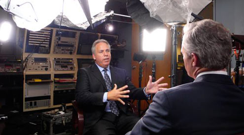 CBS News' Scott Pelley interviews Larry Register, former news director of Al Hurra. <i>Credit: CBS News</i>