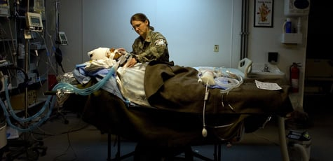 Intensive care unit ward nurse Cynthia Warwick tends to a patient at the combat support hospital on the U.S military forward operating base at Camp Salerno on Nov. 25, 2008 in Khost, Afghanistan. (Paula Bronstein/Getty Images)