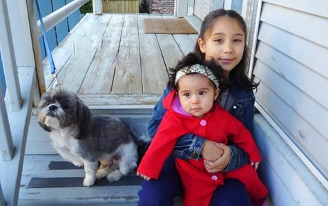 Marial Fernandez's two children in front of their Chicago home, which is now worth half the size of the mortgage. Fernandez was denied a permanent loan modification after making trial payments for seven months.