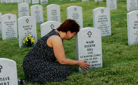 On the one-year anniversary of her husband's suicide, Barb Dill breaks down at her husband's tombstone. Wade Dill, a Marine Corps veteran, took a contractor job in Iraq. Three weeks after he returned home for good, he committed suicide (Francine Orr / Los Angeles Times / Redding, CA / July 16, 2007).