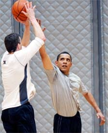 President Barack Obama plays basketball with Education Secretary Arne Duncan. In his ethics letter, Duncan – who headed Chicago Public Schools – promises not to participate in any matters in which Chicago Public Schools are involved. Official White House Photo / Pete Souza