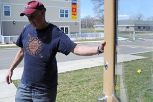 Ed Neufeldt, a volunteer with the Faith Mission, opens the door of a former funeral parlor being transformed into a homeless shelter for families and single women at the Faith Mission in Elkhart, Indiana on April 8, 2009.  Neufeldt lost his job in the mailroom with the Monaco Corp last October and says, All I know is RVs. (Amanda Rivkin/ProPublica)