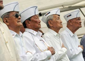 Sen. Daniel Inouye (D-HI) championed a provision in the stimulus bill that authorizes $198 million of payments to Filipino WWII veterans. (File photo by Romeo Gacad/AFP/Getty Images)