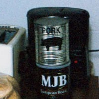 A can of pork from a food bank. One of the first stimulus contracts is $16.8 million to Lakeside Foods for canned pork. (gunnyrat/Flickr Images)