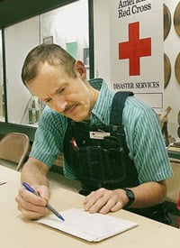 Bruce Ivins is seen at the American Red Cross Emergency Shelter at the Frederick Community College in September 2003. (Credit: Frederick News-Post)