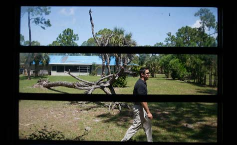 Jim Banford from Real Estate Asset Disposition Corp. walks through one of the foreclosed properties his company is trying to resell in Jupiter, Fla. (Joe Raedle/Getty Images/April 2008)