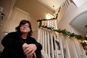 Sarah Murphy is photographed in her home in Phoenix, Ariz. After losing her job, Murphy almost lost her home to auction, but in an 11th-hour reprieve, her lender approved an ajustment that added $30,000 in fees. (Laura Segall/ProPublica)