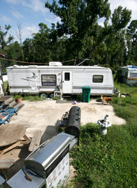 A FEMA trailer sits on the Lee family's lot in in Coden, Ala. Saturday, Aug. 23, 2008. (Bill Starling/ProPublica)