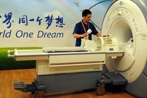 A technician demonstrates an MRI machine in a GE Healthcare clinic at the Beijing Olympic Village (Getty Images file photo).