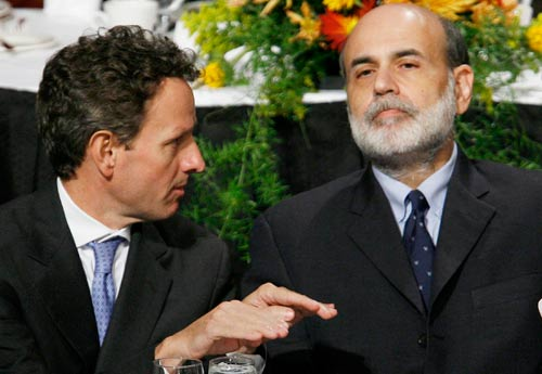 Federal Reserve Chairman Ben Bernanke (right) listens to President of the Federal Reserve Bank of New York Timothy Geithner before addressing the Economic Club of New York, in this October 15, 2008 file photo. (Lucas Jackson/Reuters)