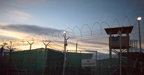 The sun rises over Guantanamo detention facility, at the U.S. Naval Base, in Guantanamo Bay, Cuba, Nov. 19, 2008. (AP Photo/Brennan Linsley, File)