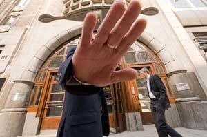 A security guard tries to stop a photographer taking pictures of the offices of Goldman Sachs in London (Leon Neal/AFP/Getty Images)