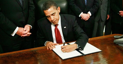 U.S. President Barack Obama signs an executive order to close down the detention center at Guantanamo Bay Cuba at the White House on January 22, 2009 in Washington, DC.  (Photo by Mark Wilson/Getty Images)
