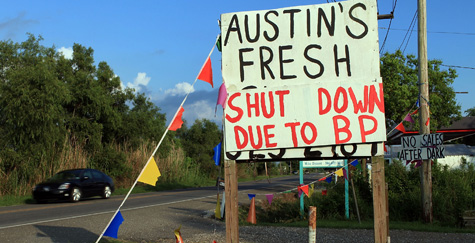 A sign announces the closing of a seafood stand in Lafourche, La., due to the oil spill, June 13, 2010. (Photo by Spencer Platt/Getty Images)