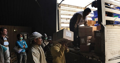 Afghan employees from the Independent Election Commission load election materials into a truck to be sent to provinces on Oct. 22, 2009. Afghanistan's presidential rivals are reigniting their campaigns for a second vote, but two previously unreleased audits produced by U.N. investigators raise questions about the integrity of the elections commission. (Shah Marai/AFP/Getty Images)