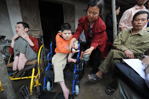 Hoang Van Hue with his disabled children and his wife, Ung Thi Tam. Hue, a former Vietnamese infantryman, says he was exposed to Agent Orange dropped by American troops during the war. (Hoang Dinh Nam/AFP/Getty Images)