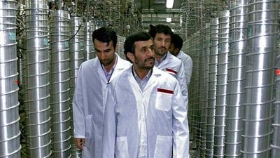 Iranian President Mahmoud Ahmadinejad, center, visits the Natanz uranium enrichment facilities on April 8, 2008. (Photo by the Office of the Presidency of the Islamic Republic of Iran via Getty Images)
