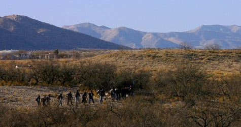 Mexican immigrants attempt to cross the Mexico-U.S. border from Sasabe, in the state of Sonora into the Arizona desert on April 6, 2006. (Omar Torres/AFP/Getty Images)