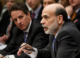 Treasury Secretary Timothy Geithner, left, listens as Federal Reserve Chairman Ben Bernanke speaks at a House Financial Services Committee hearing on March 24, 2009. (Brendan Smialowski/Getty Images)