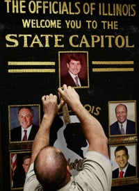 Derek Needham removes the official picture of Illinois Gov. Rod Blagojevich from the State Capital after he was removed from office by the Illinois Senate on Jan. 29, 2009. (Scott Olson/Getty Images)