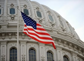 The U.S. flag flies at the U.S. Capitol. (Stan Honda/AFP/Getty Images)
