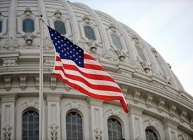 The U.S. flag flies at the U.S. Capitol. (Stan Honda/AFP/Getty Images)