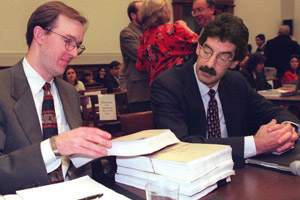 James Cole, right, independent counsel representing the House Ethics Committee and his assistant, Kevin Wolf, deliver a report to the Ethics Committee on Capitol Hill on Jan. 17, 1997. The special counsel investigating ethics violations charges against House speaker Newt Gingrich recommended that the speaker be fined $300,000 and given a reprimand. (Luke Frazza/AFP/Getty Images)